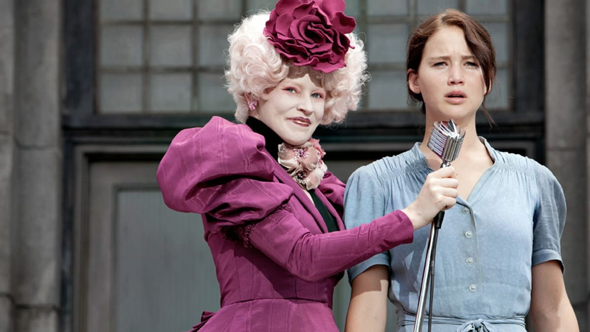 Katniss speaking up with Effie at the first Reaping of the Hunger Games series